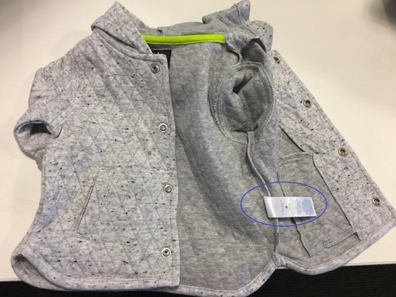 The CPSC offers instructions for identifying jackets affected by the recall. (CPSC)