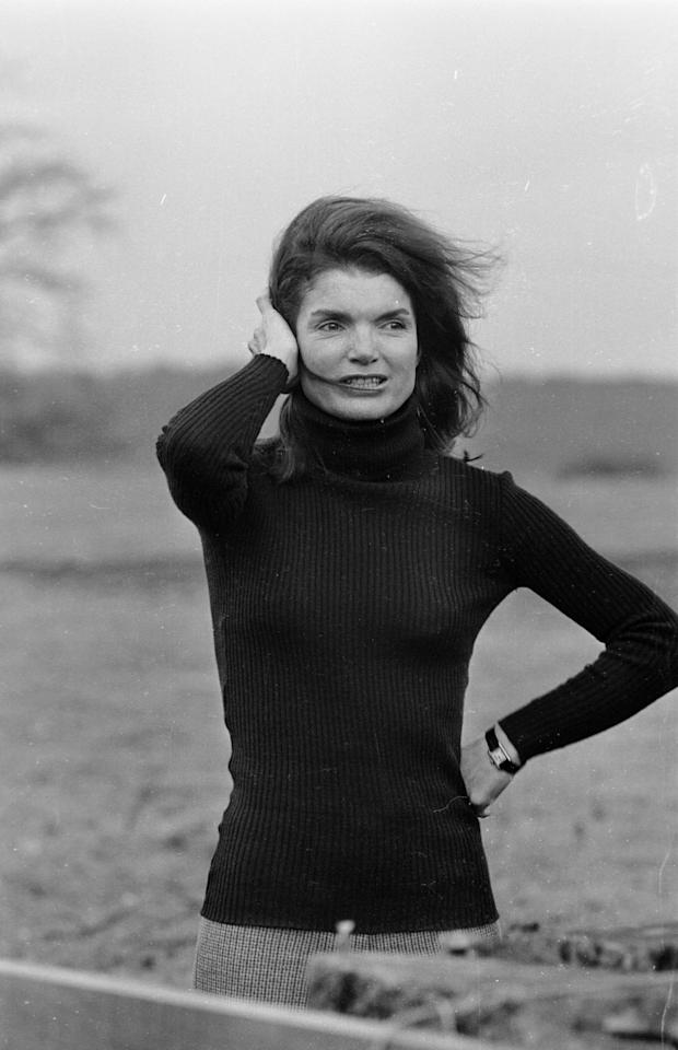 Jackie looks windswept on a December afternoon in 1969 in a casual black turtleneck. Photo courtesy of Getty Images.