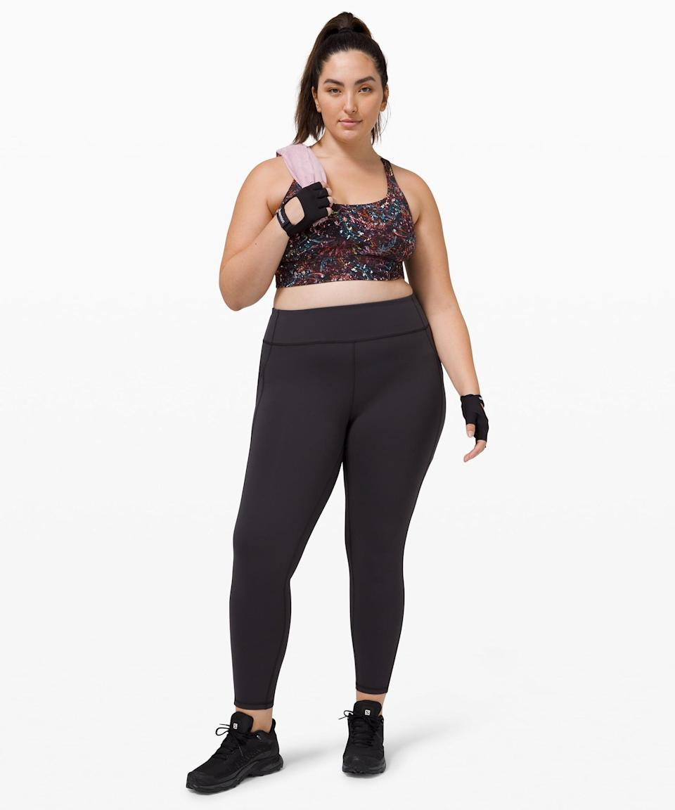 <p>I'm someone who likes to switch up my workouts; one day I'm doing my favorite Pilates workout, and the next I'm sweating it out on my Peloton bike. While I respect the fact that different pants are built for different activities, sometimes you just want one versatile piece that can move with you. Enter the <span>Lululemon Invigorate High-Rise Tight</span> ($128). It's specifically designed to take you through a multitude of workouts; it's made of Everlux so it's sweat-wicking and breathable but thick enough to provide support, and it doesn't have a back zipper, allowing you to lie down in Pilates or yoga. Plus, it has side pockets. So basically, sold.</p>