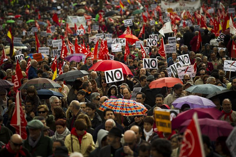 People take part on a protest during the May Day rally in the center of Madrid, Tuesday, May 1, 2012. Tens of thousands of workers marked May Day in European cities Tuesday with a mix of anger and gloom over austerity measures imposed by leaders trying to contain the eurozone's intractable debt crisis.Spain's Prime Minister Mariano Rajoy is trying desperately to cut a bloated deficit, restore investor confidence in Spain's public finances, lower the 24.4 jobless rate, and fend off fears it will join Greece, Ireland and Portugal in needing a bailout.(AP Photo/Daniel Ochoa de Olza)