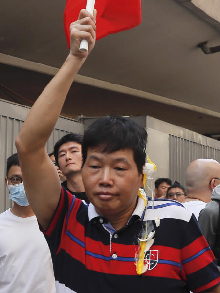 A pro-China supporter is thrown an egg by anti-government protesters at the Kowloon Bay district in Hong Kong, Saturday, Sept. 14, 2019. The clashes came after several nights of peaceful rallies that featured mass singing at shopping malls by supporters of the months-long protests demanding democratic reforms. (AP Photo/Kin Cheung)