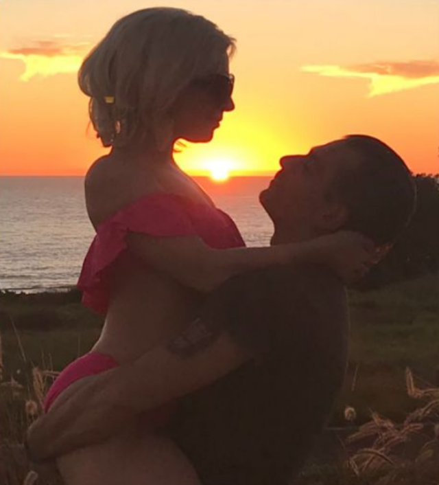"""<p>Talk about a perfect sunset. The songstress shared this stunning photo of herself cradled in boyfriend Christian Carino's arms, while wearing a flouncy pink bikini, as the sun went down on Sunday. """"Night night, Sunday Funday,"""" she wrote. (Photo: <a href=""""https://www.instagram.com/ladygaga/"""" rel=""""nofollow noopener"""" target=""""_blank"""" data-ylk=""""slk:Lady Gaga via Instagram"""" class=""""link rapid-noclick-resp"""">Lady Gaga via Instagram</a>) </p>"""