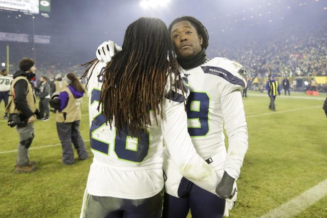 Seattle Seahawks' Shaquem Griffin and Shaquill Griffin embrace after an NFL divisional playoff football game against the Green Bay Packers Sunday, Jan. 12, 2020, in Green Bay, Wis. The Packers won 28-23 to advance to the NFC Championship. (AP Photo/Darron Cummings)