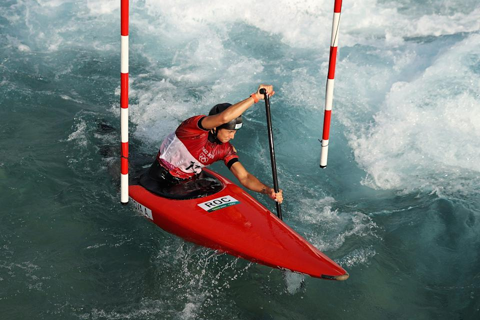 """Russia's Alsu Minazova trains at the Kasai Canoe Slalom Centre on July 22. The """"ROC"""" acronym is visible on his kayak."""