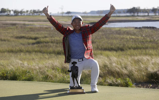 C.T. Pan celebrates with his trophy after winning the RBC Heritage golf tournament at Harbour Town Golf Links on Hilton Head Island, S.C., Sunday, April 21, 2019. Pan won with a 12-under par for his first PGA victory. (AP Photo/Mic Smith)