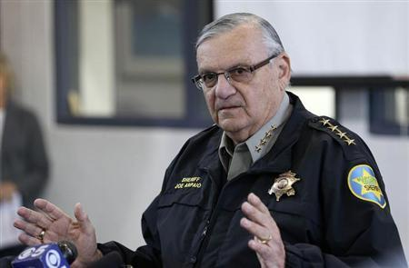 Maricopa County Sheriff Joe Arpaio watches as actor Steven Seagal addresses the media about a simulated school shooting in Fountain Hills