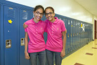 In this Thursday, June 6, 2013 photo, Kiran Awatramani, left, and her twin sister, Chiara, one of the 24 sets of twins from Highcrest Middle School in Wilmette, Ill., pose for a portrait in Wilmette, Ill. The group is attempting to break a Guinness Book of World Records for the amount of twins in one grade which is currently 16 sets. (AP Photo/Scott Eisen)