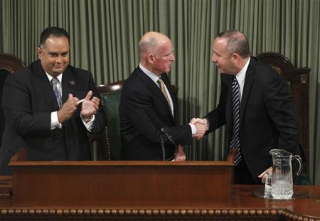 California Governor Brown is congratulated by Senate President Pro Tempore Steinberg at the State Capitol in Sacramento.