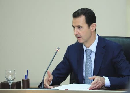 Syria's President Bashar al-Assad heads a meeting of his new cabinet in Damascus