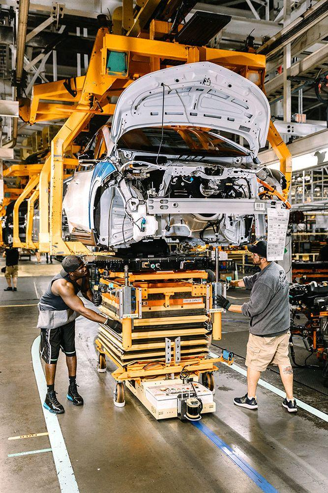 Workers assembling a Chevy Bolt electric vehicle at the Orion Assembly Plant in Orion Township, Mich., near Detroit.