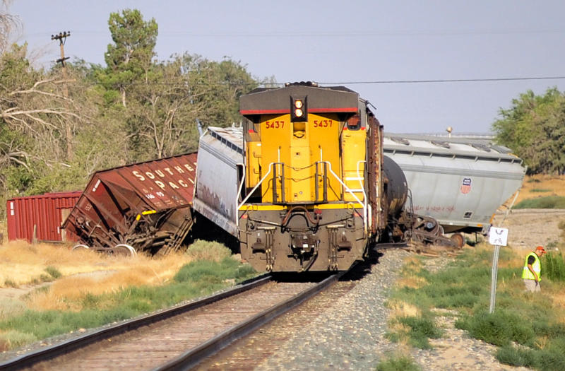 A freight train that derailed Wednesday, July 27, 2011, in Littlerock, Calif., in the high desert of north Los Angeles County toppled 21 cars and forced the evacuation of 250 homes while firefighters looked for for possible chemical leaks. No one was injured after 21 of 68  cars toppled off the tracks. (AP Photo/Josh Edelson)