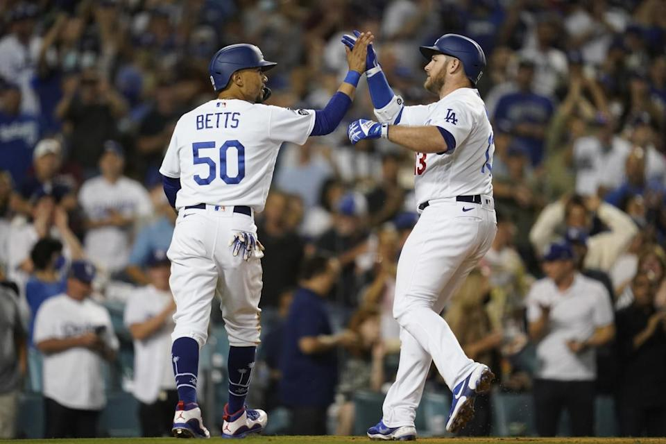 Max Muncy celebrates with Mookie Betts after hitting a two-run home run.
