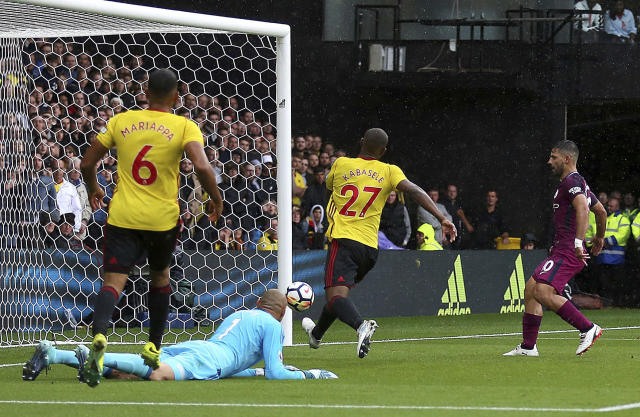 <p>Manchester City's Sergio Aguero, right, taps in his side's second goal against Watford during their English Premier League soccer match at Vicarage Road in Watford, England, Saturday Sept. 16, 2017. (Nigel French/PA via AP) </p>