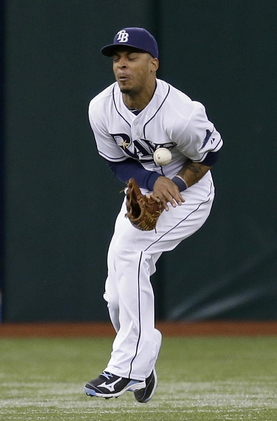 Tampa Bay Rays center fielder Desmond Jennings fields a seventh-inning single by Los Angeles Angels' Chris Nelson during a baseball game Tuesday, Aug. 27, 2013, in St. Petersburg, Fla. (AP Photo/Chris O'Meara)