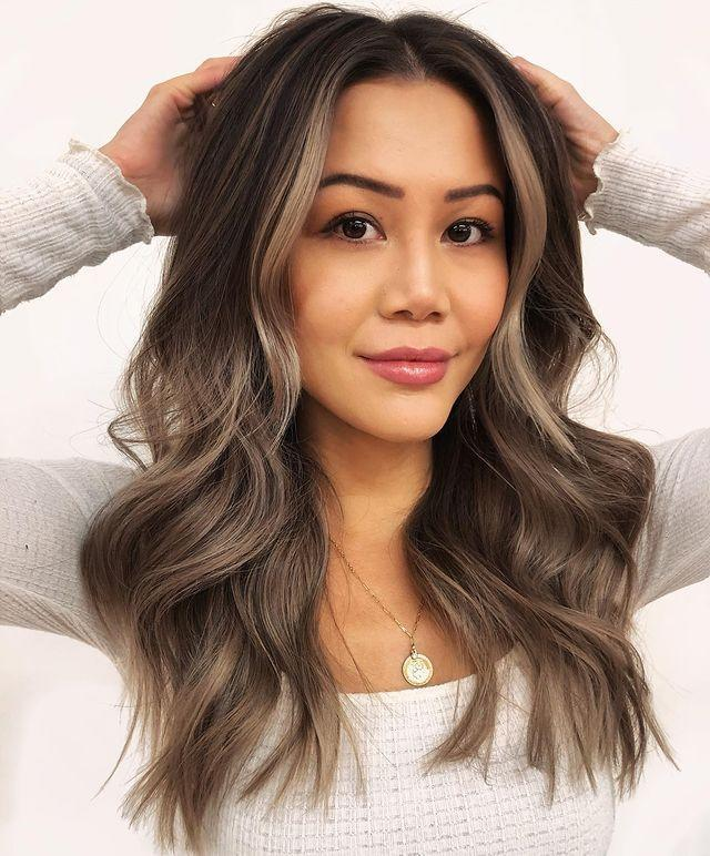 """<p>A couple face-framing pieces really takes this ash-brown hair color to the next level. Don't you love how they <strong>brighten up the entire face</strong>?</p><p><a href=""""https://www.instagram.com/p/CJwEuxmjN-F/"""" rel=""""nofollow noopener"""" target=""""_blank"""" data-ylk=""""slk:See the original post on Instagram"""" class=""""link rapid-noclick-resp"""">See the original post on Instagram</a></p>"""