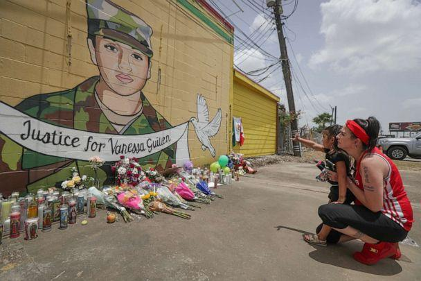 PHOTO:Dawn Gomez holds her 3-year-old granddaughter, Saryia Greer, who waves at Vanessa Guillen's mural painted by Alejandro 'Donkeeboy' Roman Jr. on the side of Taqueria Del Sol, July 2, 2020, in Houston. (Steve Gonzales/Houston Chronicle via AP)