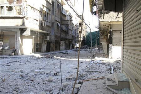 A view of a damaged street full of debris in the refugee camp of Yarmouk, near Damascus