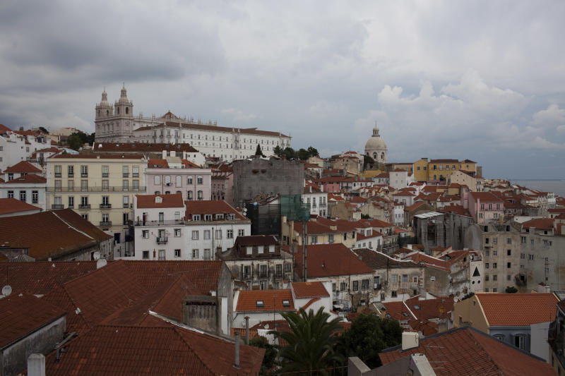 In this Sept. 28, 2012 photo, view of Lisbon's Alfama neighborhood. Portugal is scrapping its long-standing rent controls in one of the government's most radical economic and social reforms since the ailing country needed a euro 78 billion bailout last year, when it was engulfed by Europe's financial crisis. Critics say the anticipated rent hikes from next month could price thousands of families out of their homes. At the very least, the change aimed at boosting and modernizing the economy, will add to the financial burden on those struggling to cope with pay cuts and tax hikes designed to ease the country's crippling debt load. (AP Photo/Armando Franca)