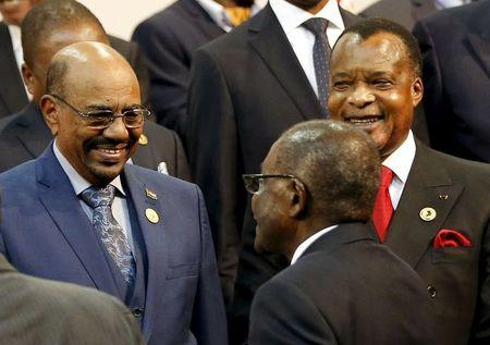 President of the Congo Republic Denis Sassou Nguesso looks on as Sudan's President Omar al-Bashir smiles while being greeted by Zimbabwe's President Robert Mugabe ahead of the African Union summit in Johannesburg