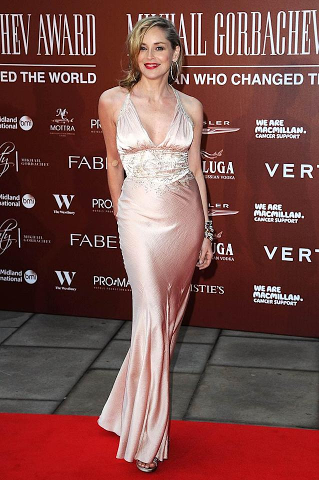 "Sharon Stone sported a similar, negligee-inspired silk dress to a recent gala held at Royal Albert Hall in London, England. The 53-year-old oozed Old Hollywood glamour thanks to her pale pink Christian Dior gown and bright red lipstick. Eamonn McCormack/<a href=""http://www.gettyimages.com/"" target=""new"">GettyImages.com</a> - March 30, 2011"