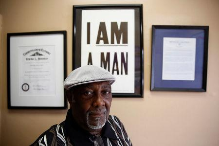 "Henry Leach poses for a photograph as he stands under a commemorative ""I am a Man"" sign at Ms. Girlees's Soul Food restaurant in Memphis, Tennessee, U.S., March 29, 2018. Leach, who participated in the strike 50 years ago, said King came to the city for justice, not violence. ""He came to help us get what we wanted. Like I tell you, he became like a father to us,"" the former sanitation worker, said recently. REUTERS/Jonathan Ernst"