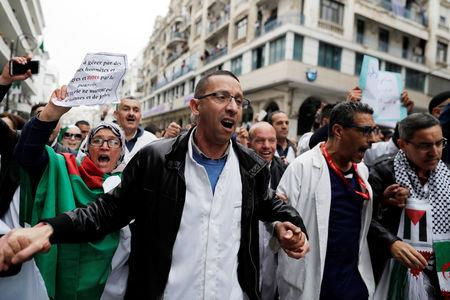 Doctors chant slogans as they march during a protest calling on President Abdelaziz Bouteflika to quit, in Algiers, Algeria March 19, 2019. REUTERS/Zohra Bensemra