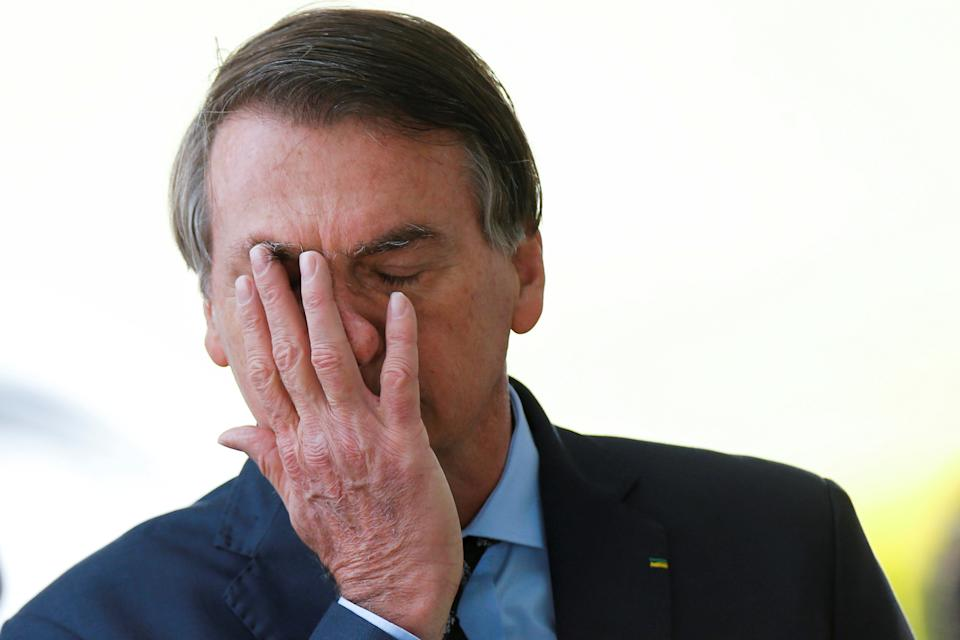 Brazil's President Jair Bolsonaro reacts while meeting supporters as he leaves Alvorada Palace, amid the coronavirus disease (COVID-19) outbreak, in Brasilia, Brazil, April 9, 2020. REUTERS/Adriano Machado     TPX IMAGES OF THE DAY