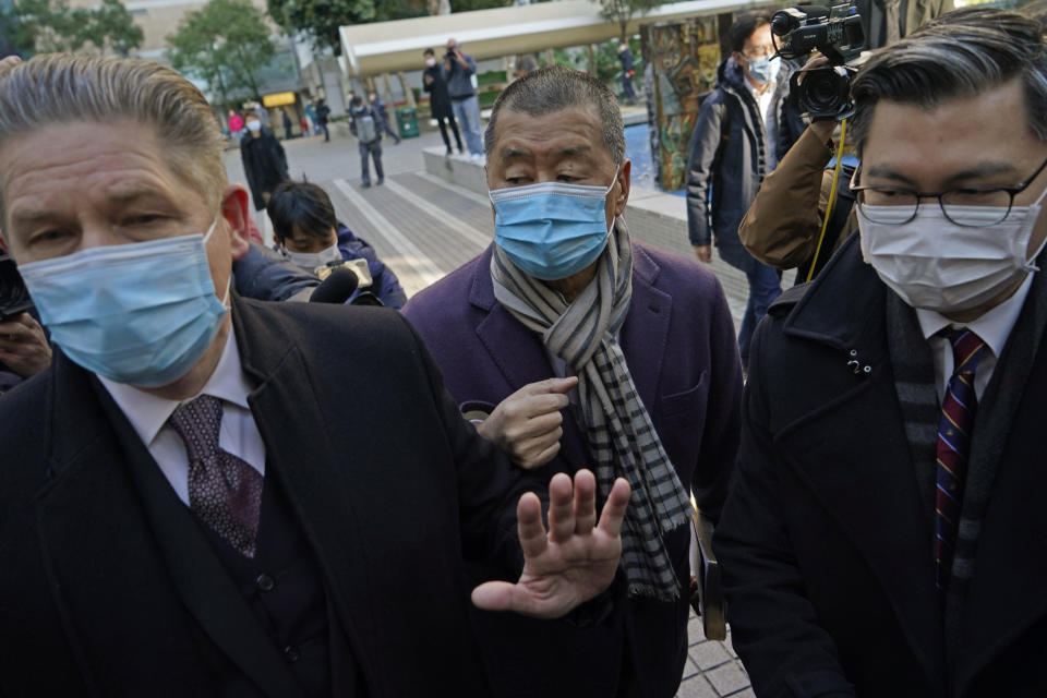 Hong Kong pro-democracy activist and media tycoon Jimmy Lai, center, arrives at the Court of Final Appeal during a break in Hong Kong, Thursday, Dec. 31, 2020. Lai appeared in court Thursday as prosecutors asked the city's top judges to send him back to detention after he was granted bail last week on fraud and national security-related charges. (AP Photo/Kin Cheung)