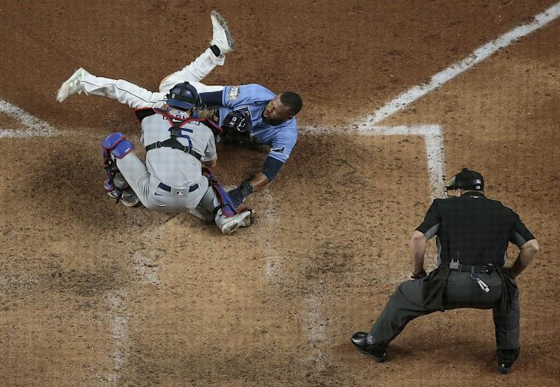 Arlington, Texas, Sunday, October 25, 2020 Tampa Bay Rays right fielder Manuel Margot (13) is tagged out.