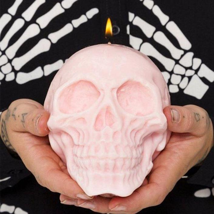 """<p><strong>EmberCandleCo</strong></p><p>etsy.com</p><p><a href=""""https://go.redirectingat.com?id=74968X1596630&url=https%3A%2F%2Fwww.etsy.com%2Flisting%2F226475028%2Flarge-skull-candle-100-soy-wax-vegan&sref=https%3A%2F%2Fwww.bestproducts.com%2Flifestyle%2Fg23118150%2Fthe-craziest-halloween-things-thatll-make-you-go-boo%2F"""" rel=""""nofollow noopener"""" target=""""_blank"""" data-ylk=""""slk:Shop Now"""" class=""""link rapid-noclick-resp"""">Shop Now</a></p><p>Now <em>this</em> is a Halloween candle. The hand-poured soy wax candles come in more than 11 scents and a bunch of pastel colors.</p>"""