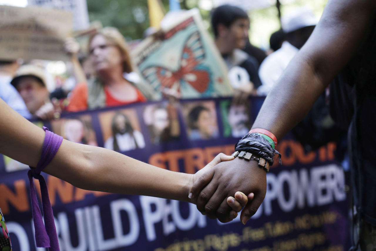 Demonstrators walk during a protest march, Sunday, Sept. 2, 2012, in Charlotte, N.C. Demonstrators are protesting before the start of the Democratic National Convention. (AP Photo/Patrick Semansky)