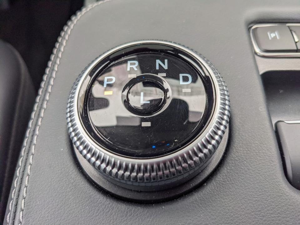 <p>This is actually pretty slick. Just spin the bezel to switch gears and tap the L to toggle one-pedal driving. However, it does get sketchy when backing out of my driveway and into busy street traffic because I have to look down at the shifter to ensure I'm actually in Drive and not Neutral.</p>