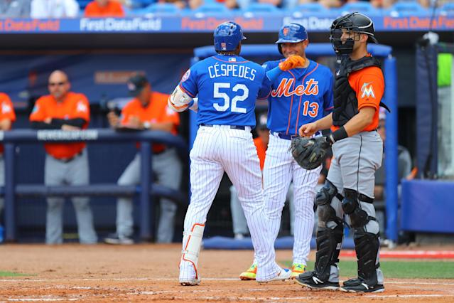 <p>New York Mets outfielder Yoenis Cespedes (52) is congratulated by a smiling Asdrúbal Cabrera after crushing a home run in the second inning of a baseball game against the Miami Marlins at First Data Field in Port St. Lucie, Fla., Feb. 25, 2018. (Photo: Gordon Donovan/Yahoo News) </p>