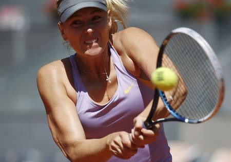 Maria Sharapova of Russia returns the ball to Li Na of China during their match at the Madrid Open tennis tournament