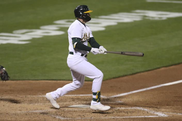 Oakland Athletics' Seth Brown watches his RBI single against the Tampa Bay Rays during the seventh inning of a baseball game in Oakland, Calif., Friday, May 7, 2021. (AP Photo/Jed Jacobsohn)