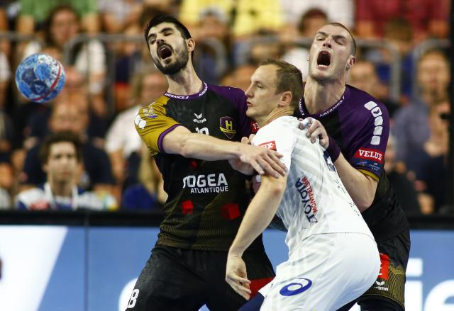 Handball - Men's EHF Champions League Final - HBC Nantes vs Montpellier HB - Lanxess Arena, Cologne, Germany - May 27, 2018. Valentin Porte of Montpellier HB in action against Eduardo Gurbindo and Romaric Guillo of HBC Nantes. REUTERS/Thilo Schmuelgen