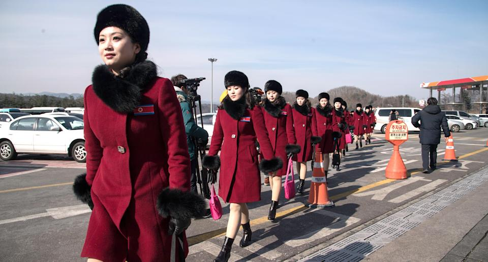 North Korean cheerleaders on their way to the 2018 PyeongChang Winter Olympic Games. (Photo: Ed Jones/AFP/Getty Images)