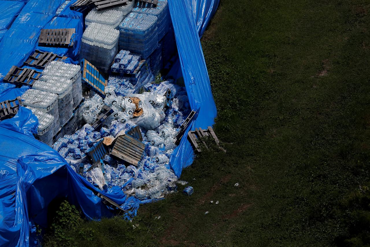 About 20,000 pallets of unused water bottles are seen along an airplane runway a year after Hurricane Maria devastated Puerto Rico in Ceiba, Puerto Rico, September 18, 2018. Picture taken September 18, 2018. REUTERS/Carlos Barria      TPX IMAGES OF THE DAY