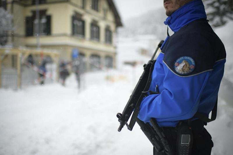 Security: A police officer at Davos for the start of the World Economic Forum (EPA)