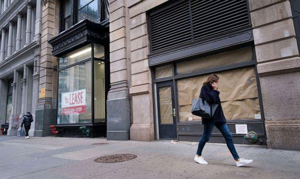 PHOTO: In this Jan. 8, 2021, file photo, a pedestrian walks past closed retail stores in New York. (Justin Lane/EPA via Shutterstock, FILE)