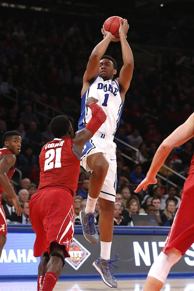Duke's Jabari Parker (1) shoots against Alabama's Rodney Cooper (21) during the first half of an NCAA college basketball game in the semifinals of the NIT Season Tip-off tournament Wednesday, Nov. 27, 2013, in New York. (AP Photo/Jason DeCrow)