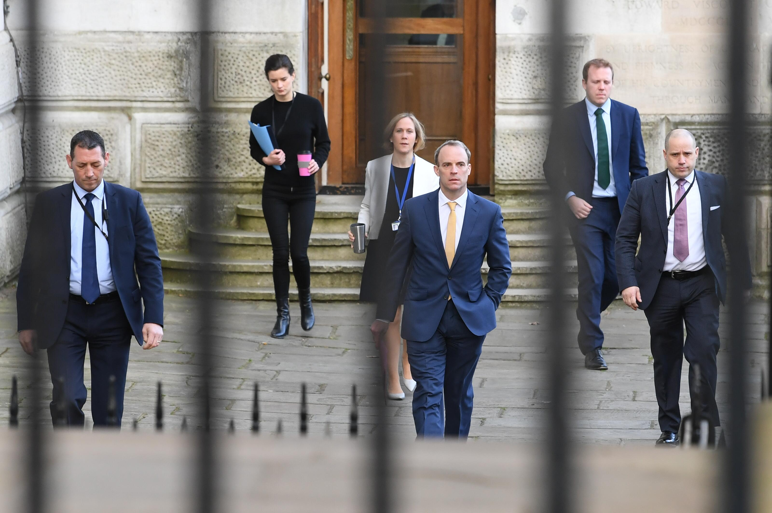 Foreign Secretary Dominic Raab (centre), who is taking charge of the Government's response to the coronavirus crisis after Prime Minister Boris Johnson was admitted to intensive care Monday, arrives at 10 Downing Street, London.