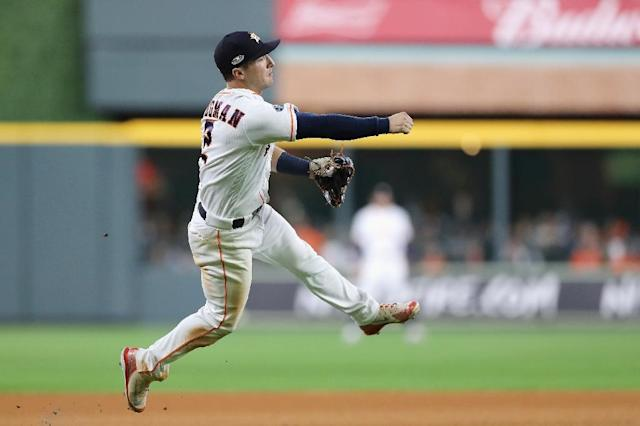 Houston's Alex Bregman, shown fielding a ball in last year's Major League Baseball playoffs, underwent right elbow surgery Friday (AFP Photo/ELSA)