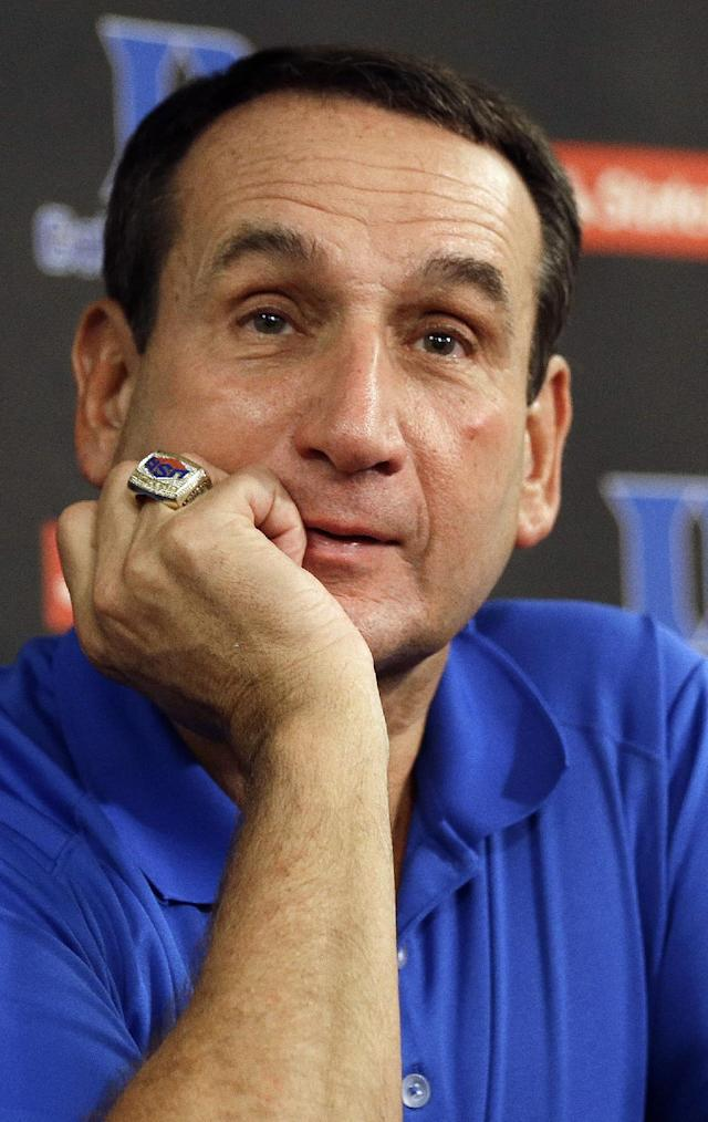 Duke coach Mike Krzyzewski listens to a question during the NCAA college basketball team's media day in Durham, N.C., Friday, Sept. 27, 2013. (AP Photo/Gerry Broome)