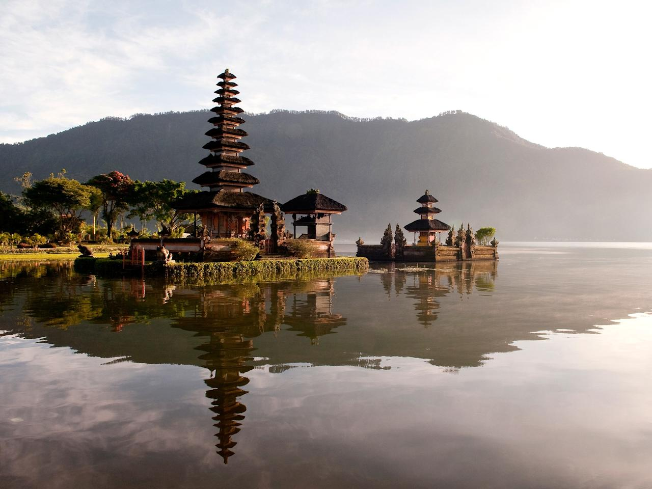 """<p>There's nowhere quite like <a href=""""https://www.cntraveler.com/destinations/bali?mbid=synd_yahoo_rss"""">Bali</a>. It's the kind of place where you'll eat the best fresh fish of your life on the beach with your feet in the sand. You'll watch whole families zoom by on motorbikes, or maybe a monkey will steal your glasses at Uluwatu temple. Despite high—and still growing—tourist numbers, you can still find vestiges of old Bali in small villages surrounded by rice paddies, where you'll hear the twinkling chimes of neighborhood gamelan ensembles rehearsing at all hours of the day and night. Note: Mount Agung, the volcano considered holy by the Balinese, has been even more active than usual for the past year, so <a href=""""https://www.cntraveler.com/story/balis-mount-agung-volcano-what-travelers-should-know?mbid=synd_yahoo_rss"""">double-check</a> the latest seismic and volcanic activity before departing.</p> <p><strong>Pro tip</strong>: Avoid Denpasar, where you fly in, and Kuta, a tourist trap; visit <a href=""""https://www.cntraveler.com/stories/2015-12-01/ubud-bali-before-the-eat-pray-love-effect?mbid=synd_yahoo_rss"""">culturally rich Ubud</a> instead, and use it as a jumping off point to explore beyond. Take a day trip to Sidemen, which has all the rice paddies without the selfie-takers, or go even farther, to the village of Munduk in the mountains.</p> <p><strong>Getting there</strong>: Many international airlines fly to Bali from hubs in Singapore, Kuala Lumpur, and Hong Kong.</p>"""
