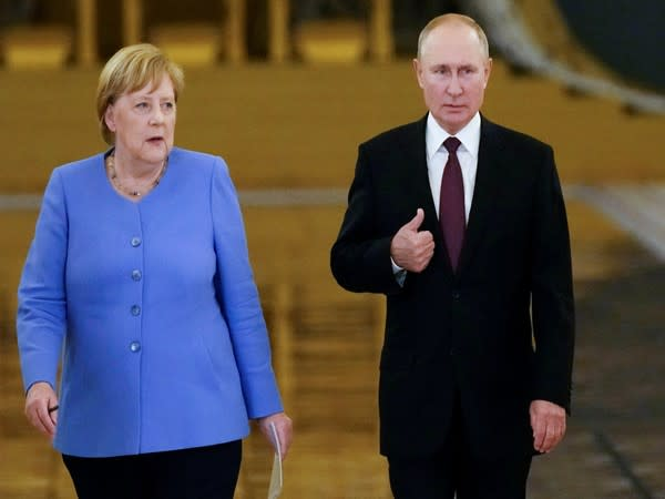 Russian President Vladimir Putin and German Chancellor Angela Merkel in Moscow, Russia August 20, 2021 [Image: Reuters]