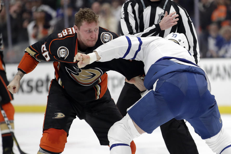 Anaheim Ducks' Nicolas Deslauriers, left, fights with Toronto Maple Leafs' Kyle Clifford during the second period of an NHL hockey game Friday, March 6, 2020, in Anaheim, Calif. (AP Photo/Marcio Jose Sanchez)