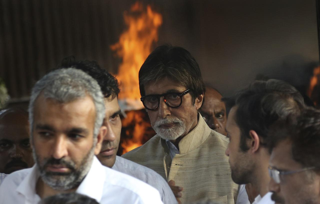 <p>Bollywood actor Amitabh Bachchan, center, attends the funeral of the Bollywood actor turned politician Vinod Khanna in Mumbai, India, Thursday, April 27, 2017. Khanna died of cancer on Thursday, a hospital official said. He was 70. (AP Photo/Rajanish Kakade) </p>