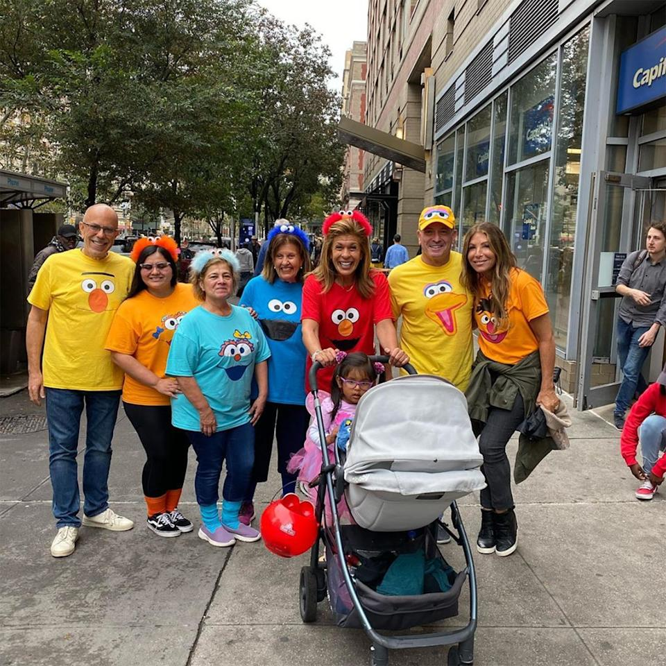 """Kotb, Schiffman and their family and friends showed out this Halloween as they made their way through N.Y.C. dressed as <a href=""""https://people.com/tv/sesame-street-anniversary-things-you-never-knew/""""><em>Sesame Street</em></a> characters."""