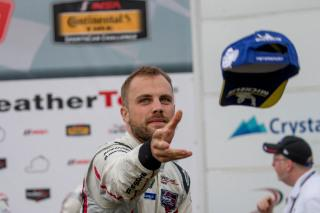 <em>Laurens Vanthoor tosses a hat to fans after a July 21, 2018 podium finish at Lime Rock Park (Brian Cleary/Getty Images).</em>